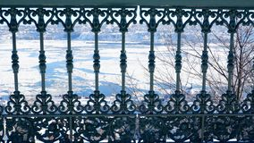 Vintage balustrade in front of the St-laurent river. In Quebec Canada, winter landscape with flakes of ice floes royalty free stock photography