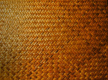 Vintage bamboo woven place mat on the wooden table background, backdrop, texture, detail, pattern, closeup.  stock photo