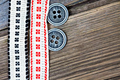 Vintage bands with embroidered ornaments and old buttons Stock Photos