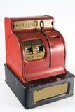 Vintage Bank. Old vintage red mechanical quarter dime and nickle bank royalty free stock photo
