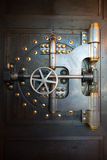 Vintage Bank Vault Door Safe. An old vintage bank vault safe door. Gives a nice industrial steampunk background. Metaphor for money, security, finance, and Royalty Free Stock Photos