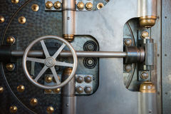 Vintage Bank Vault Safe Industrial Background. An old vintage bank vault safe door. Gives a nice industrial steampunk background. Metaphor for money, security Stock Image