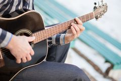 Vintage banner for site header with young man playing guitar. Music concept stock photo