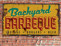 Barbeque BBQ Sign. Vintage Back Yard Barbeque BBQ Tin Sign on Brick Wall Stock Photography