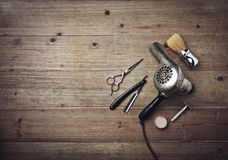 Vintage barber equipment on wood background with place for text. Set of vintage tools of barber shop royalty free stock images