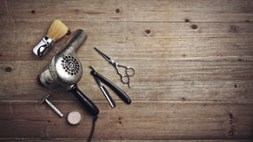 Vintage barber equipment on wood desk with place for text Royalty Free Stock Photography
