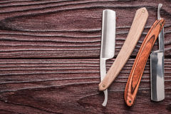 Vintage barber shop straight razor tool on wooden background. Vintage barber shop straight razor tool on old wooden background Stock Photos