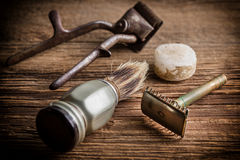 Vintage barber shop tools. Vintage barber shop tools on old wooden background. Small depth of field stock image