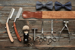 Vintage barber shop tools on wooden background. Vintage barber shop tools on old wooden background royalty free stock photography
