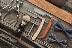 Vintage barber shop tools on wooden background Royalty Free Stock Photos
