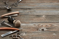 Vintage barber shop tools on wooden background. Vintage barber shop tools on old wooden background stock photos