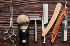 Vintage barber shop tools on wooden background. Vintage barber shop tools on old wooden background stock photo