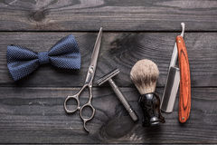 Vintage barber shop tools on wooden background Stock Photos
