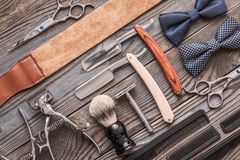 Vintage barber shop tools on wooden background Stock Image