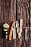 Vintage barber shop tools on wooden background Stock Photography