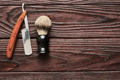 Vintage barber shop tools on wooden background Stock Images