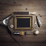 Vintage barber tools and black canvas with a frame Stock Photography
