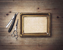 Vintage barber tools and white poster with a frame Stock Image
