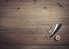 Vintage barber tools on wood background Royalty Free Stock Image