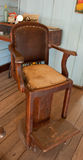 Vintage barbers chair. Old fashioned barbers shop chair Royalty Free Stock Photography