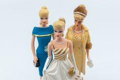 Vintage Barbie figurines against white background royalty free stock photos