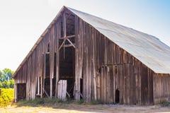 Vintage Barn in Disrepair. Old Open Air Barn In Need Of Repair Royalty Free Stock Photography