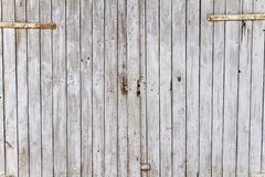 Vintage Barn Door. Weathered old barn door, originally painted with white colour royalty free stock photography