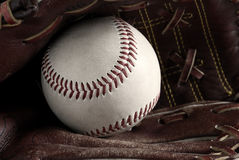 Vintage baseball. Close up of a baseball in a vintage leather glove Royalty Free Stock Images