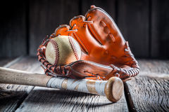 Vintage baseball ball and golden glove Royalty Free Stock Photo