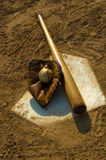 Vintage baseball on base. Vintage baseball with bat on home plate Royalty Free Stock Photography