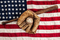 Vintage baseball. Bat and glove on an American flag Stock Photo