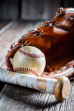 Vintage baseball bat and glove with ball Royalty Free Stock Images