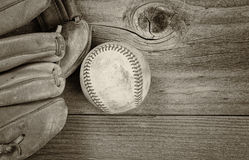 Vintage baseball Equipment on Rustic Wood Stock Image