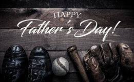 Vintage baseball gear on a wooden background with Father`s day greeting