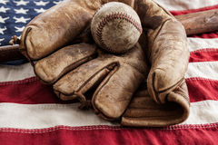 Vintage Baseball. Glove and bat on an American flag Royalty Free Stock Images