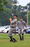 Vintage baseball. Outfielder makes the fly ball catch as his team mate backs him up at the baseball game. Vintage baseball in the summer league, Midwest, United stock photo