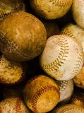 Vintage baseballs. Up close photo of a bunch of old vintage baseballs royalty free stock photo