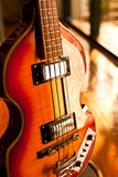 Vintage bass guitar. In music studio royalty free stock photography
