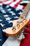 Vintage bass guitar on american flag background Stock Photography