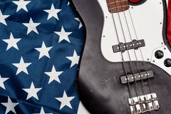 Vintage bass guitar on american flag background Stock Photo