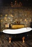 Vintage bath. In the golden dark interior royalty free stock photography