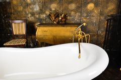 Vintage bath. In the golden dark interior stock images