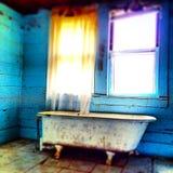 Vintage bath tub in abandoned house. Claw foot bath tub house stock photo