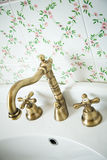 Vintage bathroom. Bronze Faucet. Stock Photo