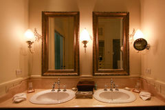 Vintage bathroom with cleaning set in hotel or resort. Interior of a classy bathroom with original furniture. Stock Image