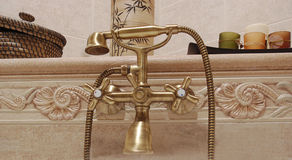 Vintage bathroom tap. Vintage golden bathroom tap closeup royalty free stock image