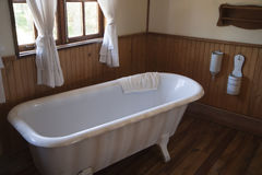 Vintage bathtub. Vintage white bathtub in a bathroom Stock Photography