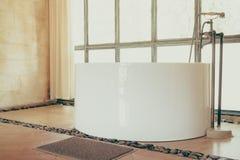 Vintage bathtub. Decoration in bathroom interior - Vintage Filter Royalty Free Stock Images