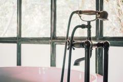 Vintage bathtub. Decoration in bathroom interior - Vintage Filter Royalty Free Stock Image
