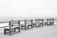 Vintage beach benches. Four vintage beach benches line up royalty free stock photo
